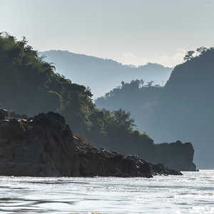 Scenic view of river with mountain range in background, River Mekong, Oudomxay Province, Laos