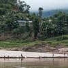 People on boats along shoreline, River Mekong, Sainyabuli Province, Laos