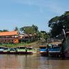 Houseboats along shoreline of River Mekong, Laos