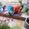 Woman takes nap at her open air vegetable shop, Luang Prabang, Laos