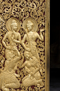 Sculpture carved on door of temple, Wat Xieng Thong temple, Luang Prabang, Laos