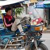 Man sitting in motorized rickshaw, Luang Prabang, Laos