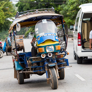 Motorized Tuk Tuk and Vehicles on road, Luang Prabang, Laos