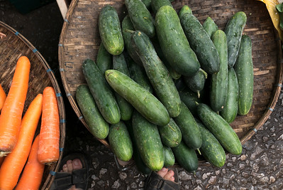 Cucumbers and carrots for sale at market stall, Luang Prabang, Laos