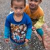 Portrait of two young boys playing, Luang Prabang, Laos