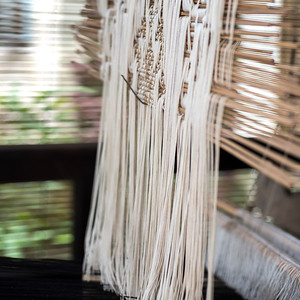 Close-up of threads hanging in a loom, Luang Prabang, Laos