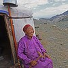 Woman sitting by ger. Western Mongolia
