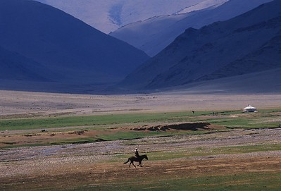 Horseman in valley. western mongolia