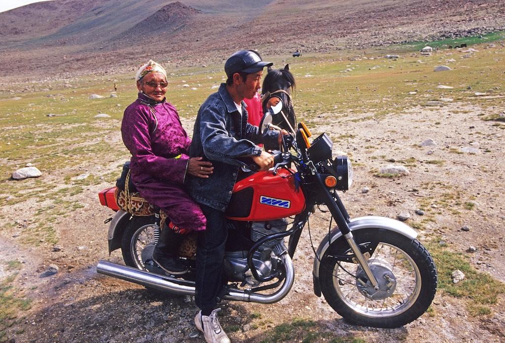 woman on motorbike. western mongolia