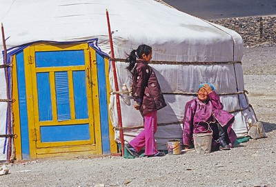Woman and girl outside ger. western mongolia