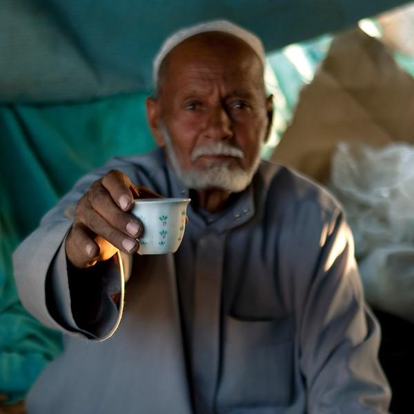 Saudi Arabia, Asir, Najran, Old Man Offering A Coffee