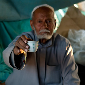 Saudi Arabia, Asir, Najran, Old Man Offering A Coffee
