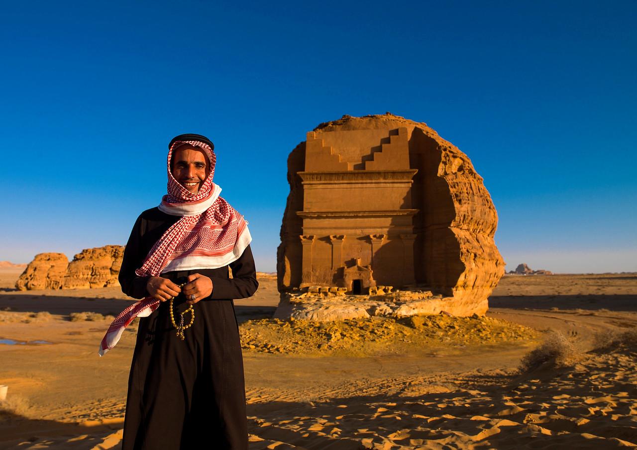 Saudi Arabia, Al Madinah Region, Al Ula, Saudi Tourist In Front Of Nabatean Tomb In Madain Saleh Archaeologic Site