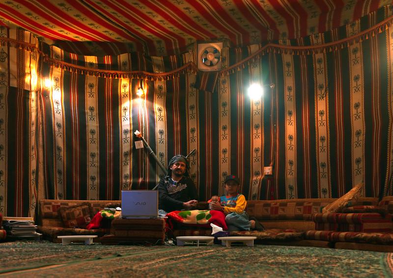 Saudi Arabia, Jazan, Al Fifa, Father And Son Inside A Tent Built Inside A Modern House