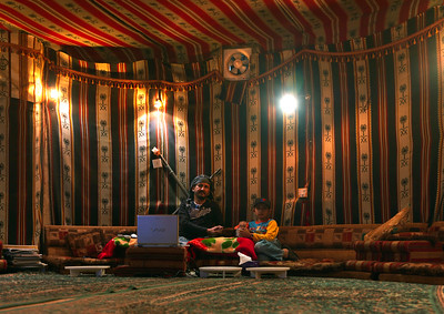 Saudi Arabia, Jazan, Al Fifa, Father And Son Inside A Tent Built Inside A Modern House