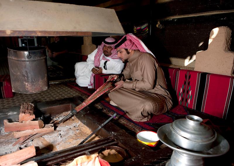 Saudi Arabia, Al Jawf Province, Sakakah, Beduin In A Tent Making Fire