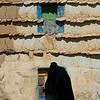 Saudi Arabia, Asir, Sarat Habidah, Saudi Woman Going Inside Her House
