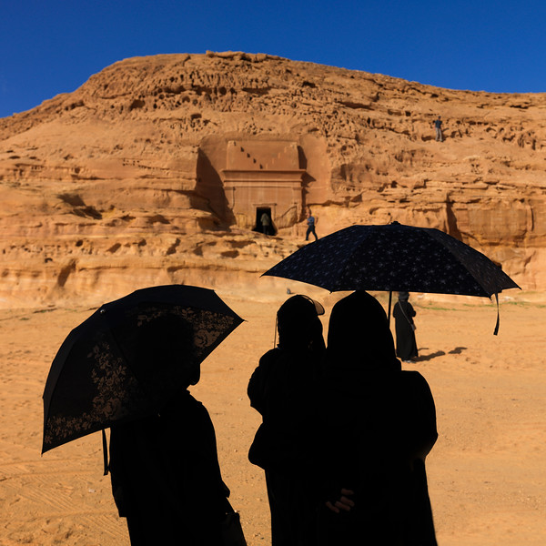 Saudi Arabia, Al Madinah Region, Al Ula, Tourists In Front Of A Nabatean Tomb In Madain Saleh Archaeologic Site
