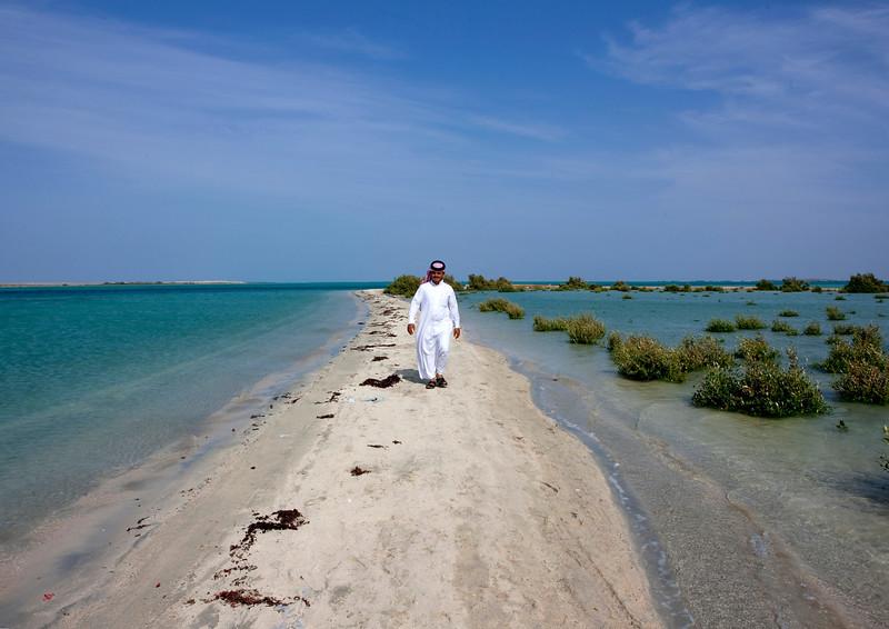 Saudi Arabia, Jizan Province, Farasan Island, Saudi Man Waking On The Beach