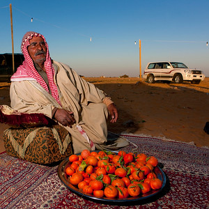 Saudi Arabia, Al Jawf Province, Sakakah, Beduin In The Desert Having Lunch