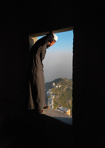 Saudi Arabia, Jazan, Al Fifa, Man Inside A House Looking Over A Window In The Mountain