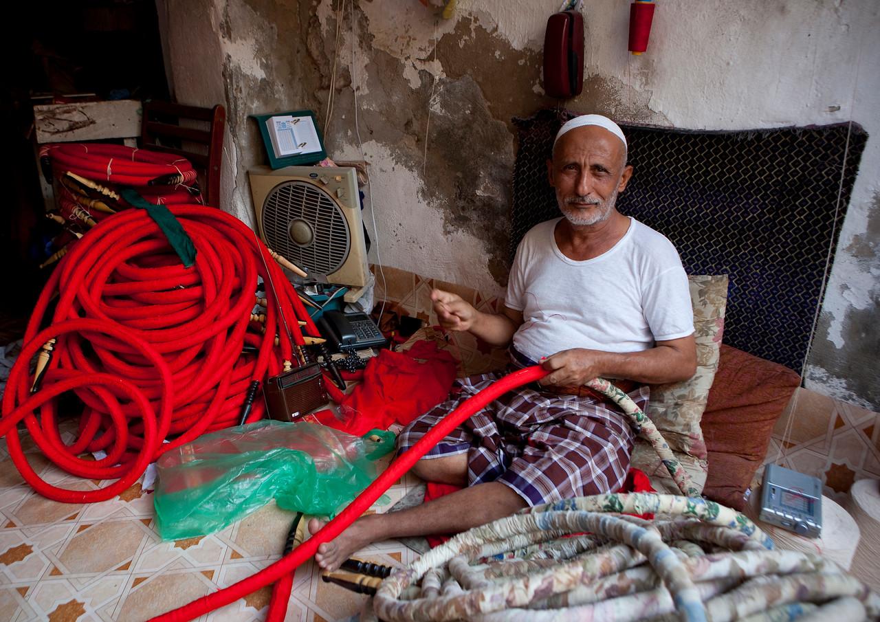 Saudi Arabia, Mecca Region, Jeddah, Saudi Man Making A Shisha