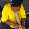 Elderly woman lighting a cigarette, Chiang Rai, Thailand