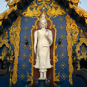 Statue of Buddha at temple, Rong Suea Ten Temple, Chiang Rai, Thailand