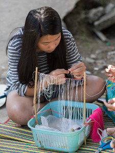 Close-up of teenage girl making craft product, Chiang Rai, Thailand