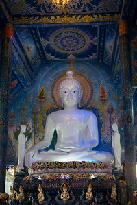 Statue of Buddha at temple, Rong Suea Ten Temple, Chiang Rai, Thailand