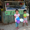 Two children playing with balloons in front of store, Koh Samui, Surat Thani Province, Thailand