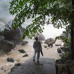 Man standing at Namuang Waterfalls, Koh Samui, Surat Thani Province, Thailand