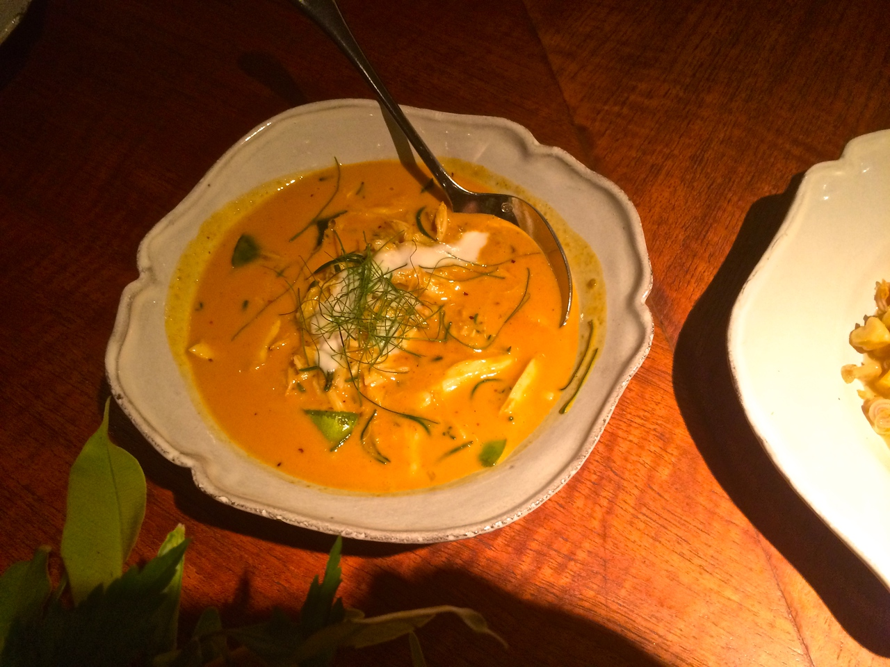 coconut and turmeric curry of blue swimmer crab with kalamansi lime