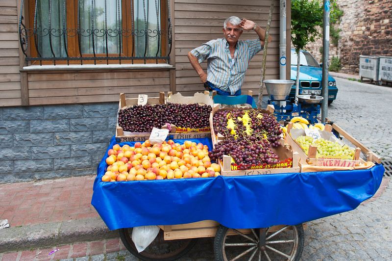 Street Vendor & His Fruit.