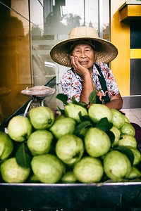 A local lady set up her guava cart outside big Bangkok bank.   2015.
