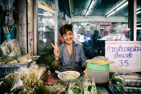 Spring rolls with mushrooms for 35Baht or green mango salad? Bangkok street vendor.  2015.