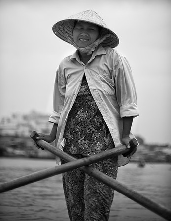 My boat captain and rower for an hour tour on the Mekong, Chau Doc, Vietnam.   2012.