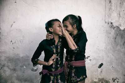 The girl on the right is known as 'the most beautiful girl in the village'. They were both making their way home from a wedding in their tiny, unassuming village on Lombok island. The girls were extremely shy about having their photo taken, but all the other villagers insisted.  2014.