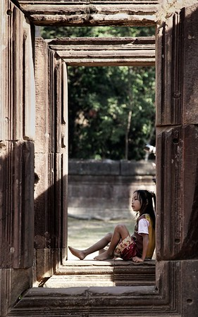 A local girl relaxes in the shade, Banteay Srei Temple, Siem Reap, Cambodia.   2012.