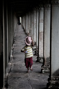 Angkor Wat, Cambodia.  This child was running to-and-fro between the pillars.   2012.