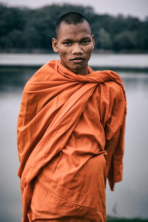 A local monk along the waters that surround Angkor Wat, Cambodia.   2012.