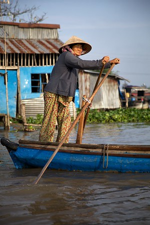 A lady makes her way home from the Phong Dien floating market - Vietnam.   2012.