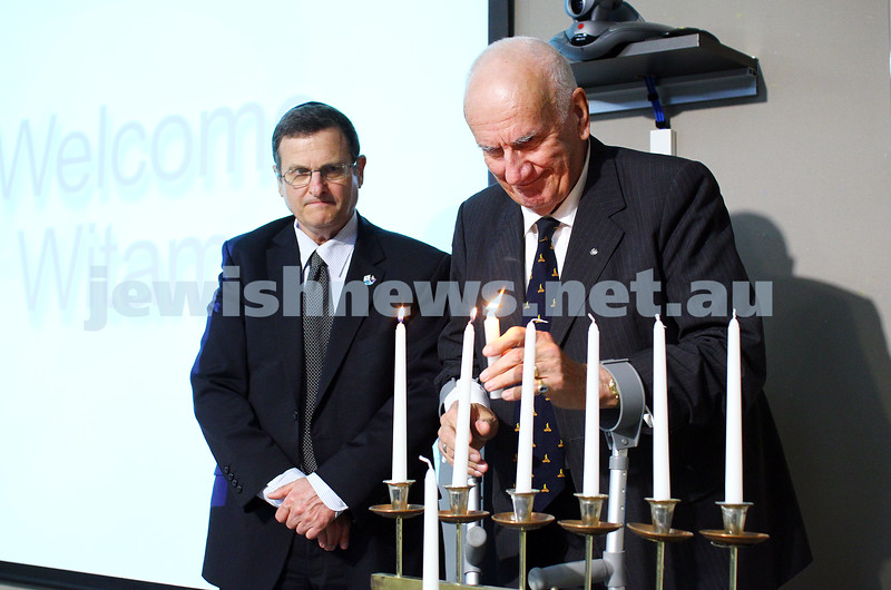 5-7-15.  The Australian Society of Polish Jews and Their Descendants event at Beth Weizmann honouring the Polish Righteous Among the Nations. Dr George Luk-Kozika, Polish Hon. Consul-General lights a memorial candle with Israeli Ambassador Shmuel Ben Shmuel looking on. Photo: Peter Haskin