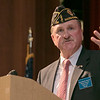 The 21st annual veteran's program at Ayer Shirley Regional High School was held on Monday, Nov. 4, 2019. Manager of the MA Veterans' Memorial Cemetery in Winchendon Claude Poirier addresses the crowd at the ceremony. SENTINEL & ENTERPRISE/JOHN LOVE