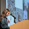 The 21st annual veteran's program at Ayer Shirley Regional High School was held on Monday, Nov. 4, 2019. Junior Jamie Kosakowski reads a letter from ASRHS graduate and West Point student Luther Salmon as his picture, in his West Point uniform, was projected on stage. SENTINEL & ENTERPRISE/JOHN LOVE