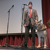 The 21st annual veteran's program at Ayer Shirley Regional High School was held on Monday, Nov. 4, 2019. Marine  Scott Dixon and his service dog Zoey talk about his PTSD as he introduces singer Jeoff Jewett who wrote a song about PTSD and sang it during the ceremony. SENTINEL & ENTERPRISE/JOHN LOVE