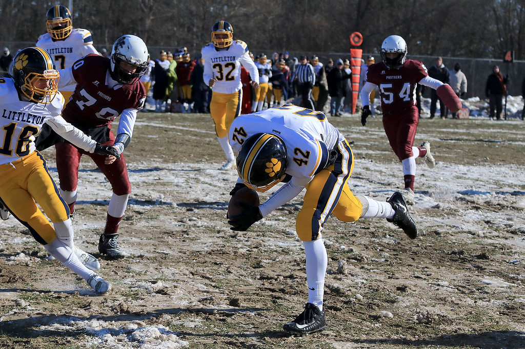 . Littleton High School visited Ayer Shirley Regional High School on Thanksgiving Day for there annual turkey day game. LHS\'s Sean Mizzoni picks up a lose ball after a punt during action in the game. SENTINEL & ENTERPRISE/JOHN LOVE