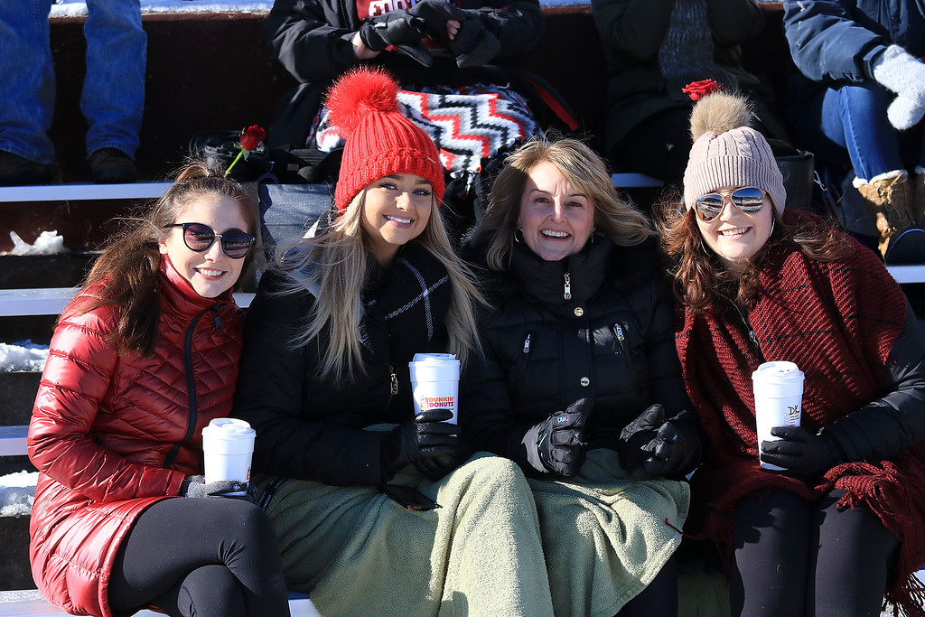 . Littleton High School visited Ayer Shirley Regional High School on Thanksgiving Day for there annual turkey day game. Danielle Mitrano, maddie Mitrano, Tina Mitrano and Katie Mitrano where staying warm as they cheer on ASRHS player Mick Mitrano. SENTINEL & ENTERPRISE/JOHN LOVE