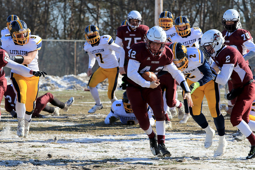 . Littleton High School visited Ayer Shirley Regional High School on Thanksgiving Day for there annual turkey day game. ASRHS\'s Mick Mitrano brakes free for some big yards during action in the game. SENTINEL & ENTERPRISE/JOHN LOVE