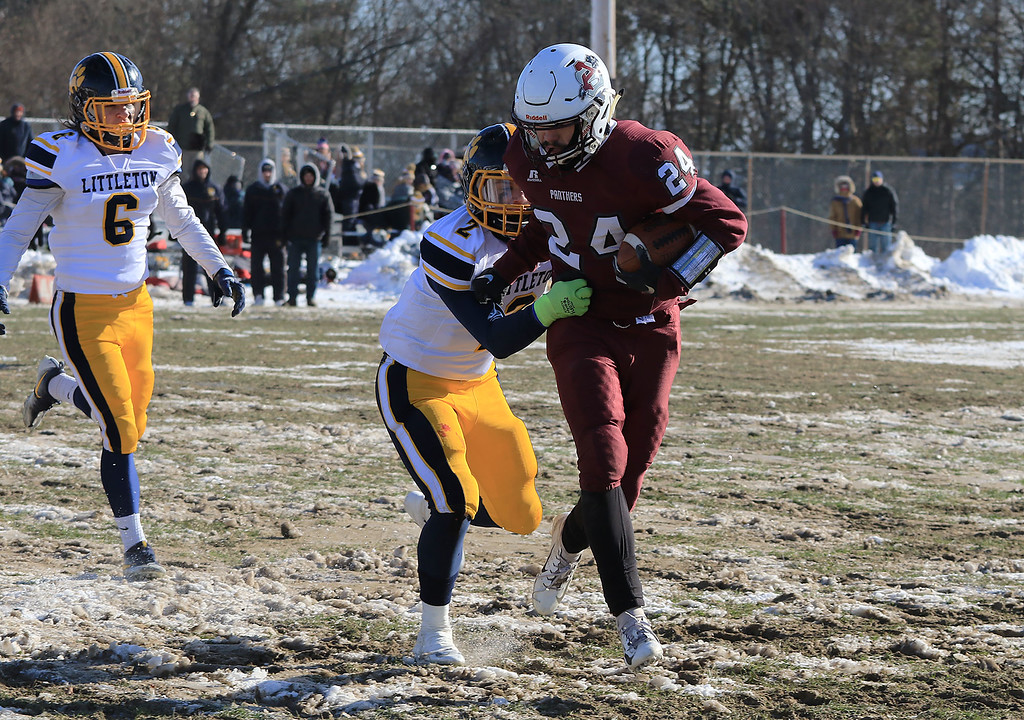 . Littleton High School visited Ayer Shirley Regional High School on Thanksgiving Day for there annual turkey day game. LHS\'s Will Scott pushes ASRHS\'s James Robinson out of bounds during action in the game. SENTINEL & ENTERPRISE/JOHN LOVE
